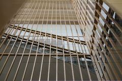 Metal bars in the prison stairs. Close-up, bottom view, cell, jail, corridor, penitentiary, justice, criminal, old, building, crime, interior, security stock photo
