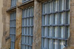 Metal bars on the Windows and doors of the Castle.  royalty free stock images