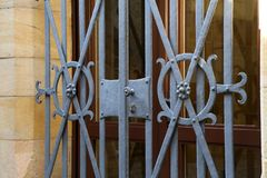 Metal bars on the Windows and doors of the Castle.  royalty free stock photos