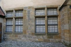 Metal bars on the Windows and doors of the Castle.  royalty free stock image