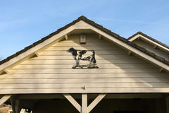 Metal bas-relief depicting a cow decorated gable house in Meerke Royalty Free Stock Images