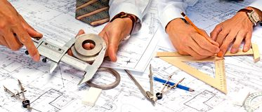 Teamwork in engineering designing stock photography