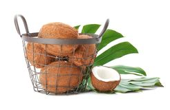 Metal basket with coconuts. On white background Royalty Free Stock Photo