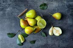 Metal basket and delicious ripe pears. On table Royalty Free Stock Images
