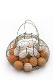 Metal basket of eggs Royalty Free Stock Photography