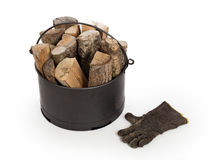 Metal basket of firewood Stock Photography