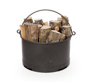Metal basket of firewood. Isolated on white Stock Photography