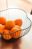 Metal basket with fresh oranges Royalty Free Stock Photography