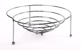 Metal basket for fruits. On the white background Royalty Free Stock Photography