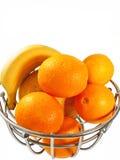 Metal  basket with orange fruits isolated Stock Image