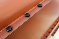 Metal beam with screws Royalty Free Stock Images