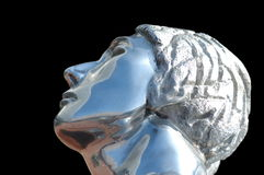 Metal beauty. Chrome female statue stock photo