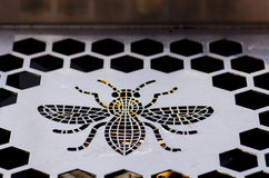 Metal bee ashtray in Manchester. Stock Image