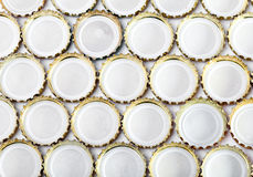 Metal Beer bottle caps.abstract background on a white background Stock Photography