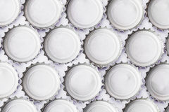 Metal beer bottle tops on white background Royalty Free Stock Image