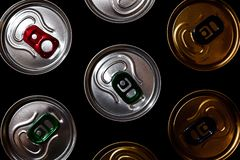 Metal beer cans background in the dark stock photos