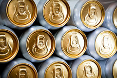 Metal  beer cans background. Metal cans with refreshing drinks background Stock Photos