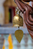 Metal bell with Buddha image in temple Royalty Free Stock Images