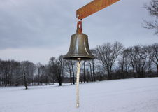 Metal Bell with Winter Snowy Fields in Background Royalty Free Stock Images