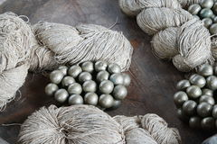 Metal bell and yarn Stock Photos