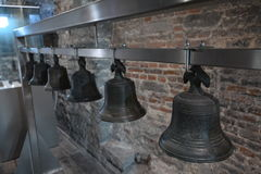 Church bells. Aligned metal bells in a cathedral in Ghent, Belgium Stock Photo