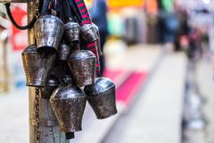 Metal bells hanging in the buddhist temple. Many old metal bells hanging on the pillar in the buddhist temple royalty free stock photography
