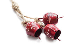 Metal bells. Three metal bells on a rope  over white Royalty Free Stock Image