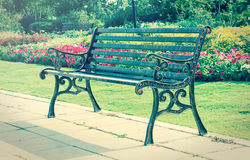 Metal bench in garden. Stock Photo