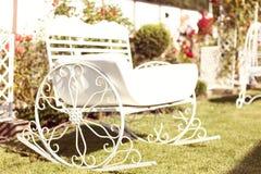 Metal bench in the garden Royalty Free Stock Photos
