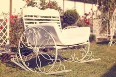 Metal bench in the garden Stock Photo