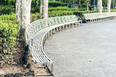 Metal bench in Giardino Bellini, famous public garden in Catania, Sicily, Southern Italy.  royalty free stock image