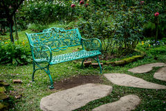 Metal bench on green grass Royalty Free Stock Photo