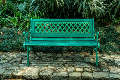 Metal bench on green grass Royalty Free Stock Photos