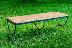 Metal bench on green grass Royalty Free Stock Images