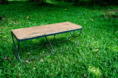 Metal bench on green grass Royalty Free Stock Image