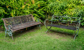 Metal bench on green grass Stock Photo