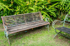 Metal bench on green grass Stock Photography