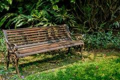 Metal bench on green grass Stock Photos