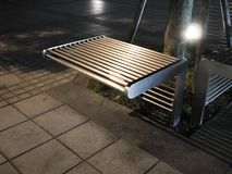 Metal bench in park Stock Photos