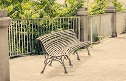 Metal bench in public garden in Acitrezza, Catania, Sicily, Southern Italy.  royalty free stock photo