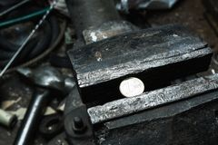 Metal bench vice with 1 euro coin Royalty Free Stock Photography