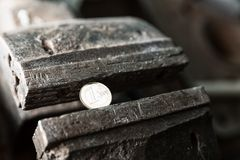 Metal bench vice with euro coin Royalty Free Stock Image