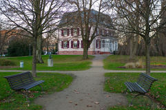 Metal benches and villa in a park of Brombach , Germany Stock Images