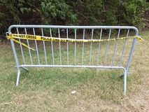Metal bike rack with yellow police line do not cross tape. On it Royalty Free Stock Photos