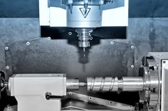 Metal billet on an industrial milling machine.Blue toning. Stock Images