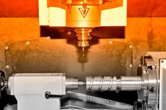 Metal billet on an industrial milling machine.Red toning. Royalty Free Stock Image