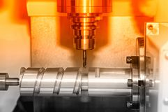 Metal billet in an industrial milling machine. Red toning. Stock Photo