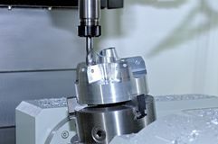 Metal billet is machined on milling machine Stock Images