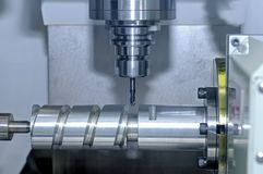 Metal billet is machined on milling machine Royalty Free Stock Photos