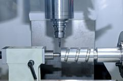 Metal billet is machined on milling machine Stock Photo